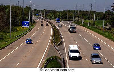 UK motorway traffic including cars and trucks.