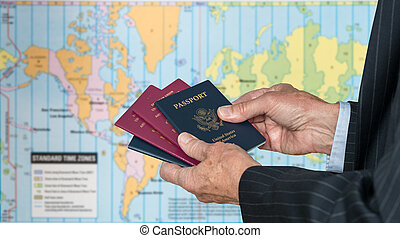 UK or US Citizen with passports and world map of timezones