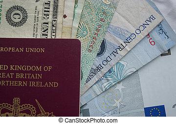 UK Passport with Money from Around the world