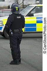 Uk Police Officer in Riot Gear