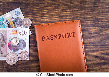 UK pound and passport. Travel to Great Britain concept....