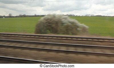 Travelling on the East Coast main line through the Bedfordshire countryside in the UK.