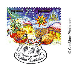UKRAINE - CIRCA 2012: cancelled stamp on Premier jour holiday envelope printed in UKRAINE, shows Ukrainian winter landscape and Christmas gifts, circa 2012. Happy New Year and Marry Christmas as text. paper isolated on white background.