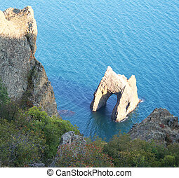 Ukraine. Crimea. Famous Golden Gate rock in Karadag park