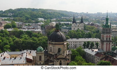 European City in spring. Densely populated areas of the city. Panorama of the ancient town. Aerial Roofs and streets Old City Lviv, Ukraine.