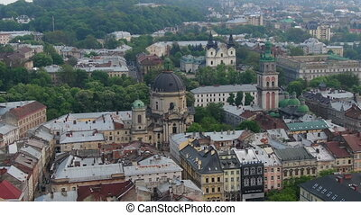 Ukraine Dominican. Central part of old city. European City in spring. Densely populated areas of the city. Panorama of the ancient town. Aerial Roofs and streets Old City Lviv, Ukraine.