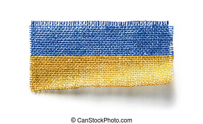 Ukraine flag on a piece of cloth on a white background