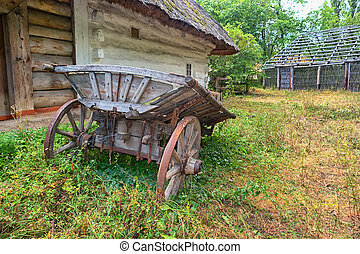 An old cart near the traditional ukraine house