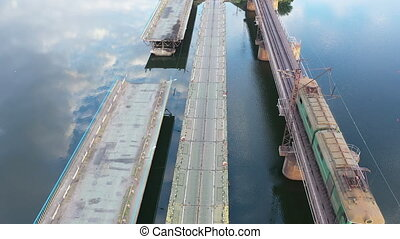Part of the bridge fell into the water, aerial view. Ukraine, the city of Pokrov.