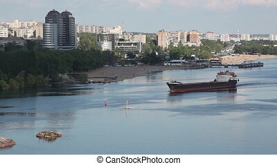 Ukraine. The city of Zaporozhye. Cargo ship sails on the river Dnieper.