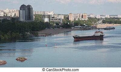 Ukraine. The city of Zaporozhye. Cargo ship sails on the river Dnieper.