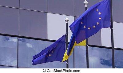 Ukrainian and Europe Union flags.
