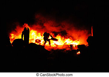 Ukrainian crisis. Protester refugee burn tires to stop the riot police. Street fights in Kyiv, Ukraine. Ukraine crisis. Fires of a Revolution.