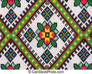 Embroidery detail from a traditional Ukrainian Rushnyky (ceremonial towel/scarf). The design is a traditional pattern called Rhombus which represents birth and feminine strength and vigor.