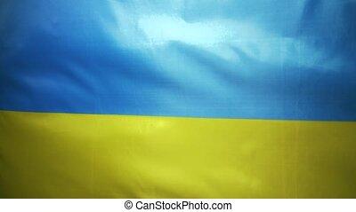Ukrainian flag flutters yellow-blue, cloth. Slow motion