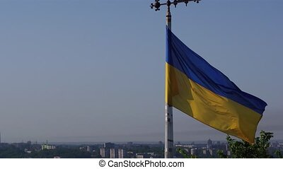 Ukrainian Flag Flying on Top of the Beautiful Panorama of the City Lviv. Aerial Shot in Lviv
