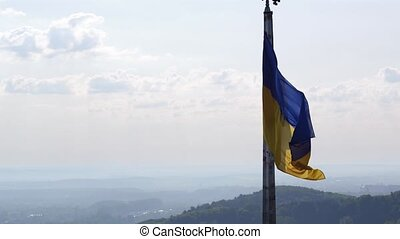 Ukrainian Flag Flying on Top of the Beautiful Panorama of the City Lviv. Aerial Shot in Ultra HD