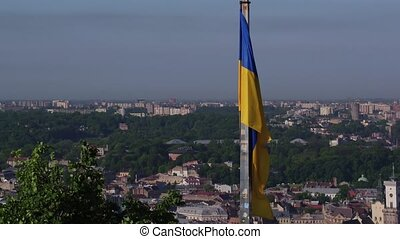 Ukrainian Flag Flying on Top of the Beautiful Panorama of the City Lviv.Aerial Shot in Lviv 4k