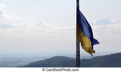 Ukrainian Flag Flying on Top of the Beautiful Panorama of the City Lviv.Aerial Shot