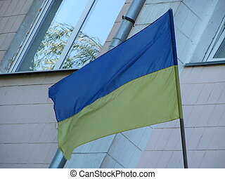 Ukrainian flag in the wind. Against the background of the sky