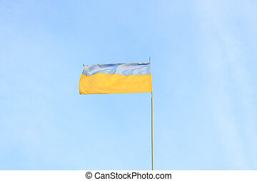 Ukrainian flag on a background of sky