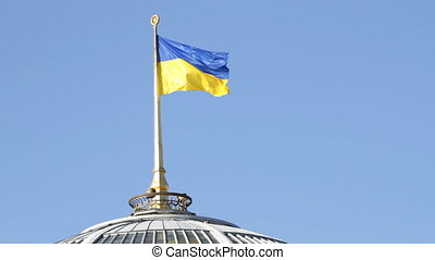Ukrainian flag on a parliament roof in Kiev