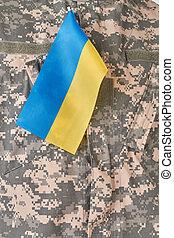 Ukrainian flag on military uniform.