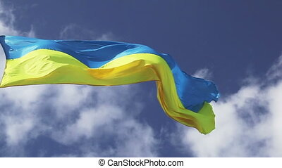 Ukrainian flag waving on clouds