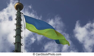 Ukrainian flag waving on cloudy