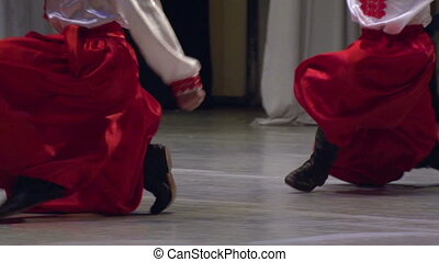 Men in Ukrainian national dress dancing on stage. Slow Motion at a rate of 120 fps