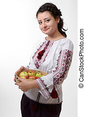 Ukrainian girl holding a bolter with apples