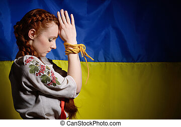 Ukrainian girl with hands tied