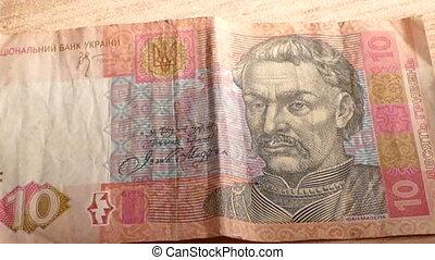 Ukrainian hryvnia and falling euro coins, mov