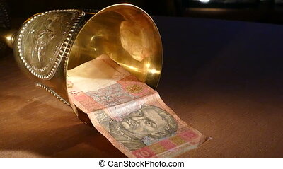 Ukrainian hryvnia dropped out of the golden cup ,mov
