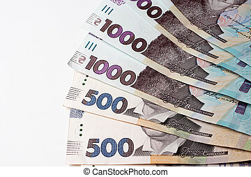 Ukrainian money on a white background. A thousand and five hundred hryvnia bills.