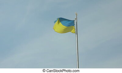 Ukrainian national flag flying waving on flagpole