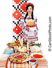 Ukrainian near table with snacks