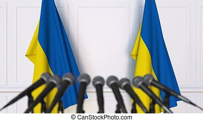 Ukrainian official press conference with flags of Ukraine....