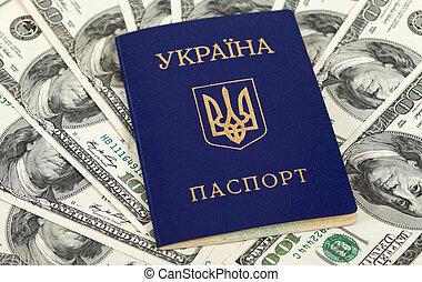 Ukrainian passport on US dollars background