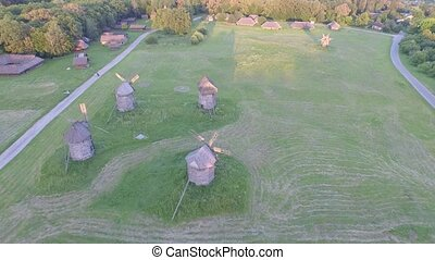 Ukrainian Pirogovo village with ancient authentic houses. 4k. Aerial view.