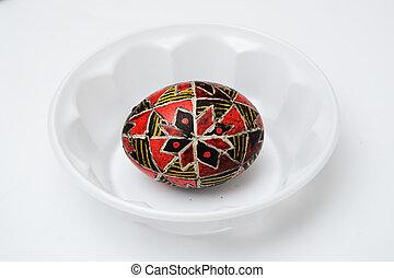 Ukrainian pisanka covered with wax