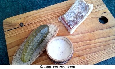 Ukrainian still life - Bacon, salted cucumber, green onions,...