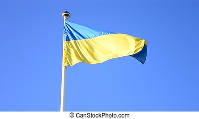 Ukrainian yellow and blue national flag fluttering blown by strong wind