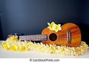 ukulele with plumeria lei