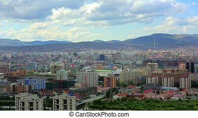 Ulaanbaatar cityscape fading into Mongolia's landscape