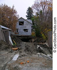 House lifted off the foundation, new footings and basement being built.