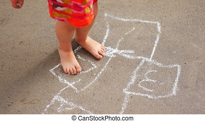 ULTRA HD 4K Young woman play hop scotch, girl jump hopscotch in summer holiday.