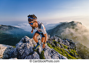 Ultra marathon athlete in the mountains during a workout