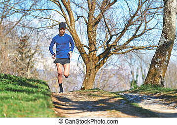 Ultra marathon man athlete during a hill workout