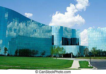 Ultra modern wavy glass office buildings in suburban...
